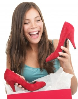 woman opening bag of shoes